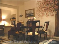 Enjoy the Comfort of the Dining Room'S Mahogany Table and Victoria'S Famous Cherry Blossoms