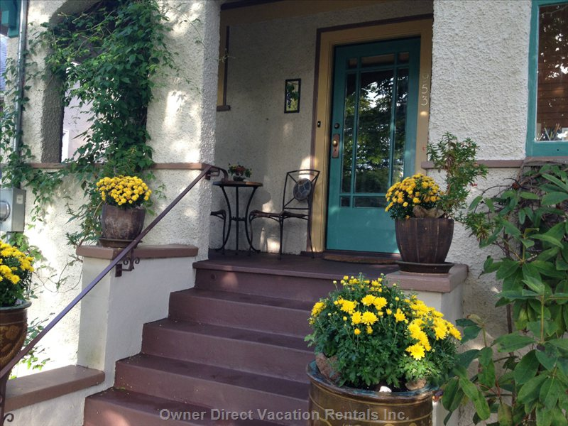 Flower Pots Welcome you up the Front Steps of our 1914 Character Home