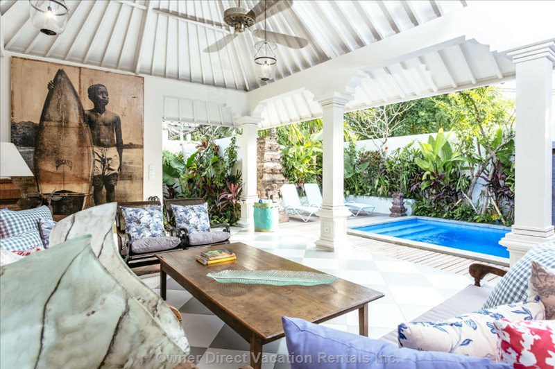 Enjoy the Pool View While Sitting in the Lounge Area