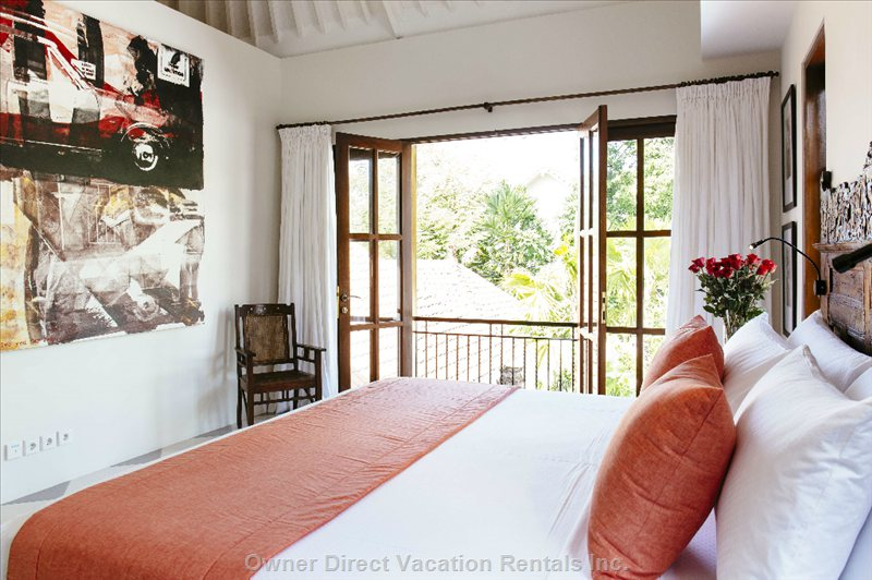 Upstairs Master Bedroom has King Bed and is Beautifully Decorated with Fantastic Artwork
