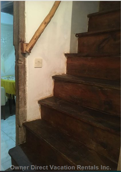 Steep Stairs Leading to the 1st Floor, Made with Noble Wood, Kept in the Traditional Way.