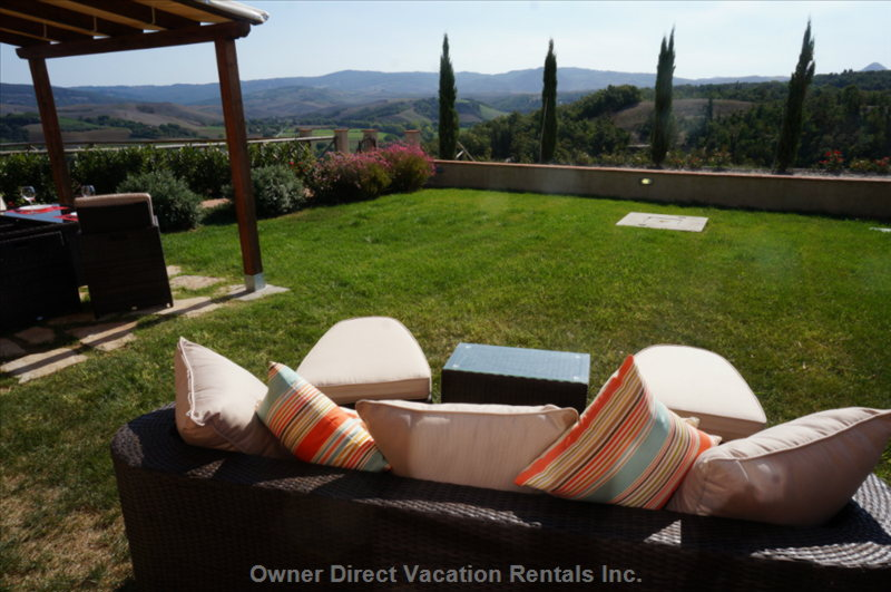 Sit back with a glass of vino and enjoy the Tuscan view - photo credit #224210
