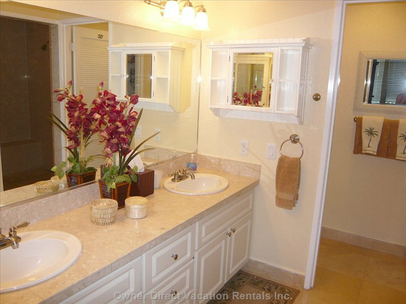 Remodeled Master Bath Features Dual Sinks and Double Shower-Heads.