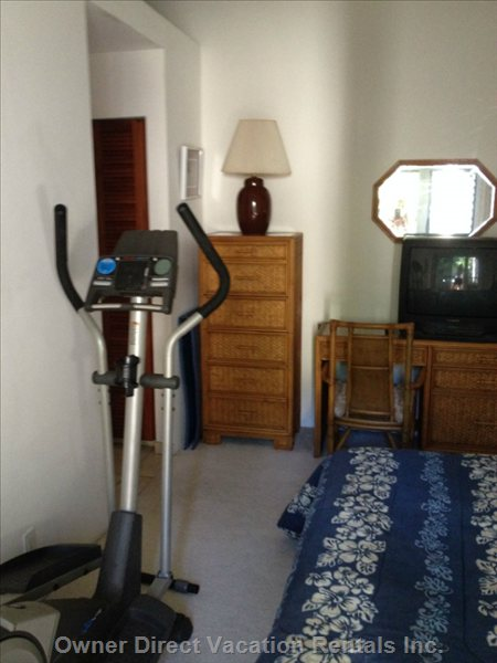 Bedroom 2  with Desk, Free Weights, and Elliptical Machine
