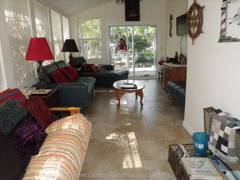 Extended Living Room Area W/ Futon Sleeps 2, Chest Filled with Assortment of Games for all Ages