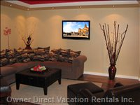 Living Room -  with Modern Decor, Sectional, Leather Chairs and a 42 Inch Lcd TV