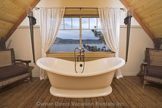 Master Bedroom with Full Ensuite and Tub with Lake View.