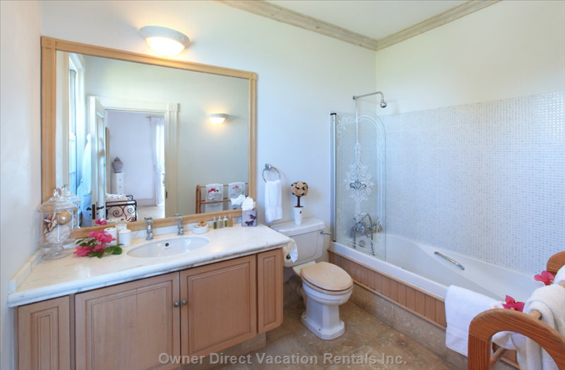 All Bedrooms Have En Suite Bathrooms with Amenities and Bathrobes for Guests' Use