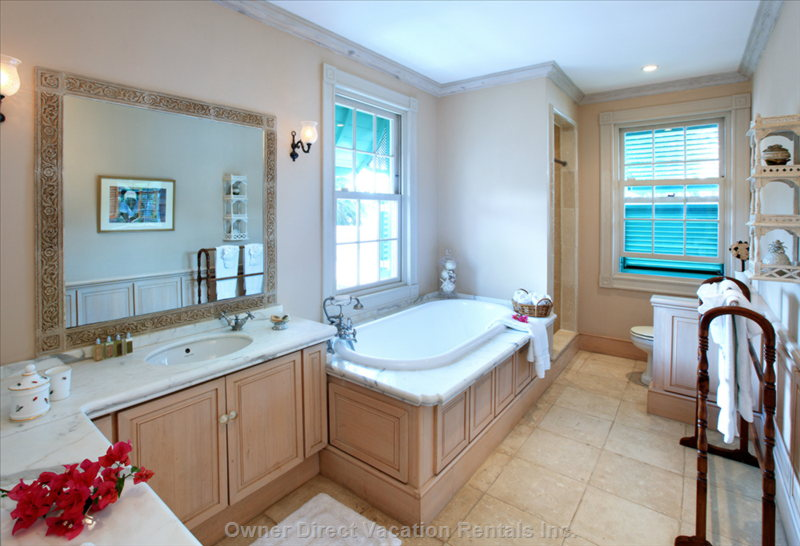Master Bathroom Suite has a Separate Tub and Shower, L'Occitane Amenities and Bathrobes for Gues