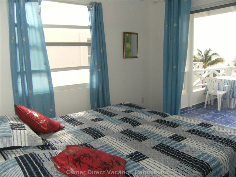Master Bedroom Upstairs, with Opening onto Large Balcony with Sea View.