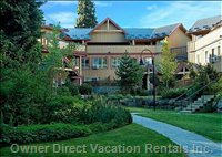 Whistler Vacation Rentals Courtyard - Glaciers Reach has an Inner Treed Courtyard that is Great for Kids to Play In.