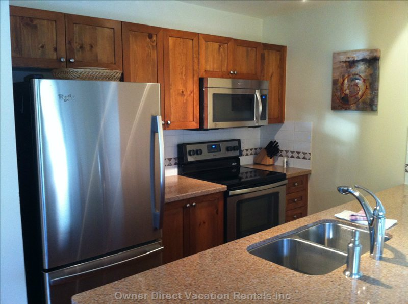 Kitchen with Updated Counters and Stainless Appliances