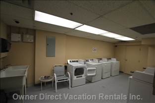 Common Laundry Room - Located at Parking Level, Coin-operated Laundry Machines.
