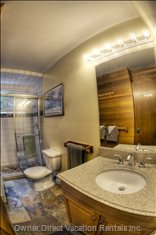 Nice Granite Counters and Natural Slate and Marble Double Shower with Bench Seat.