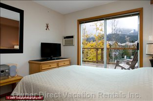 Master Bedroom  - with Queen Bed TV and Amazing Views of Whistler Mountain off the Huge Deck.