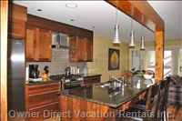 Kitchen with Granite Countertops and Ss Appliances