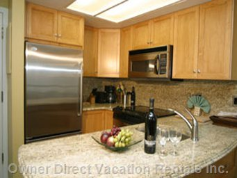 Kitchen - Fully Equipped Kitchen with Granite Counter Tops, Granite Back-splash and Full-size Stainless Steel Appliances