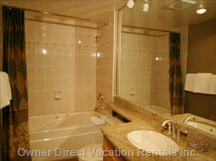 Bathroom - Full Bathroom with Granite Counter Tops and Absolutely Beautiful Single-piece Granite Slab Flooring
