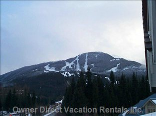 A Clear View of Whistler's Snowy Morning Runs from the Second Floor Patio.