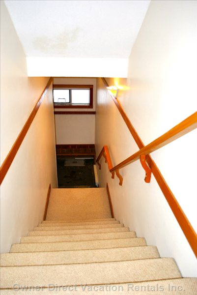 Stairs Lead from the Mudroom to the Open Concept Kitchen and Dining Room.