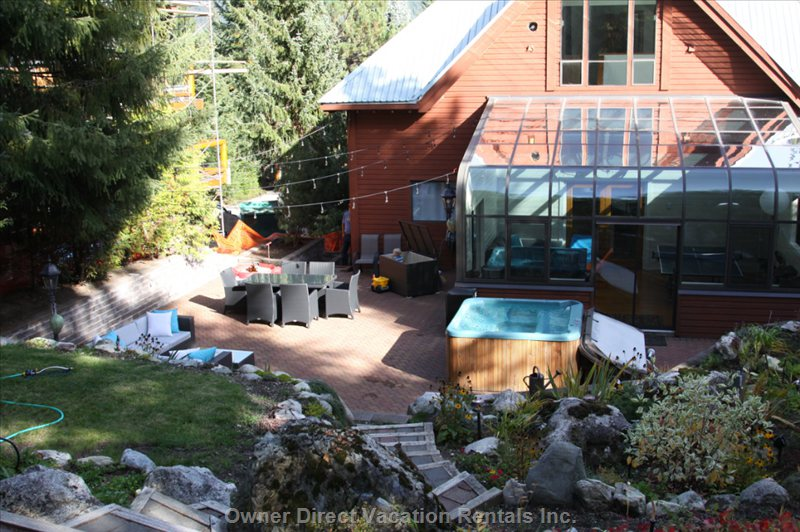 View of Massive Patio, Massive Mature Garden, Hottub, Outdoor Dining Table and Outdoor Living Area.