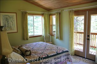 Enjoy the Views from the Upper Master Bedroom's many Windows & Private Deck