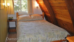 Upper Floor Right Side Bedroom with Log Frame Queen Bed.
