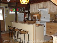 Renovated Kitchen with Island. Exterior Door Leads to West Deck with Bbq.