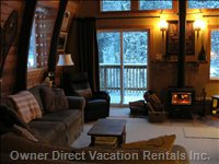 Cozy up and Enjoy Viewing the Fire around the Wood Stove.