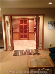 Foyer with Heated Floors and Lots of Equipment Storage and Powder Room