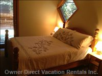 The Private Lower Level Bedroom Offers Direct Access to the Hot Tub and Ensuite with Shower.