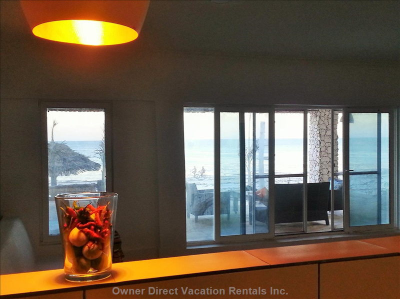A Kitchen with an Ocean View, Modern Open Plan Ikea Style Furnishings. Electrical Oven, Gas Hob/Range. Toaster, Kettle.