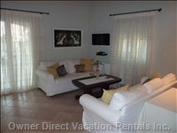 Living Room with TV and DVD Player - Enjoy a Show on the Flat Screen TV and the Comfortable Sofas