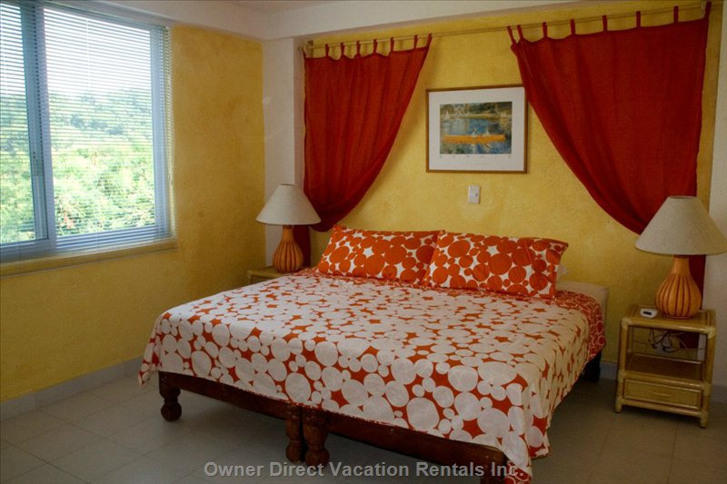 The Red Bedroom King Size Bed Can be Changed to Two Twins.  Features Private Bathroom and Shower.