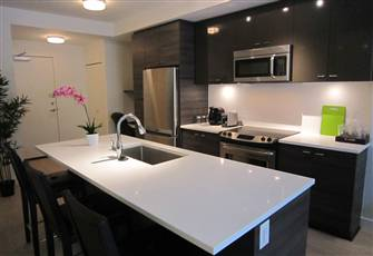 Brand New with Private Patio and Short Walk to Skytrain and Surrey Memorial Hosp