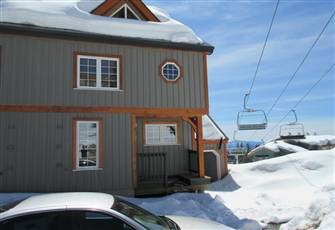 Upscale Townhouse at Village Center with Ski in/out Access.