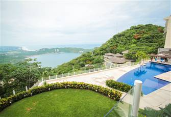 Condo with Impressive View Surrounded by Tropical Flowers, Trees & Birds.