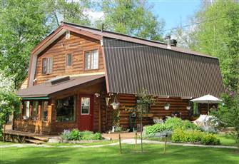 Lakeside Log House, with Beautiful Gardens, and Multiple Decks.