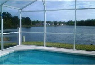 South Facing Lakefront Pool Home in Gated Community 12 Minutes to Disney