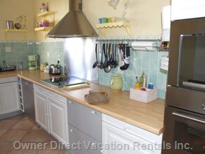 Kitchen - the Kitchen is Well Equipped with High Quality Standards. it Offers a Lot of Light and Painted in Soft Provencal Colors. you Can Also Eat in the Kitchen. you Have a Table with Four Chairs. from the Kitchen, you Have a Direct Access to the Veranda Or Winter Garden.