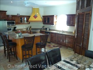Fully Equipped Kitchen - the Kitchen Counter Tops Are all Granite, the Appliances Are Top Grade Stainless Steel.   the Island with 4 Swivel Chairs Provides that Wonderful Mix of Entertaining & Food Preparation.