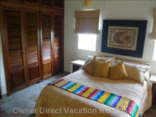Guest Suite - Queen Bed has a Pillow Top Mattress, and has an Ensuite with Walk in Shower.   There is a Large Closet W/Dresser.  a/C is Also in the 2nd Bedroom, as in the Master
