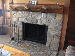 Main Level Apres Ski Fireplace - the Large Stone Fireplace for Apres Or Evening Fires Really Adds to your Ski Hill Vacation.  Sitting Back Enjoying a Movie Or Visiting with Family and Friends a Fireplace Adds Warmth and Comfort to it All.