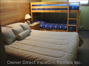 Upper Level Bedroom - the Upper Level Bedroom has a Queen Size Bed and Two Single Bunks.  There is a Closet for Storage as Required
