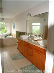 The Master Suite Bathroom is Light, Spacious and Modern, with a Granite Topped Double Vanity and Vessel Sinks.