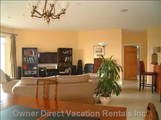 The Family Room, with Wet Bar and Cable TV. From Here you Can Walk out to the Lower Deck, which has a Swing Seat.