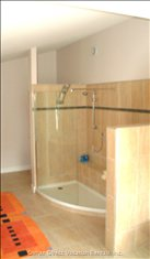 The Walk-in Shower in the Master Bathroom has Shelf Seating and 3 Shower Heads.