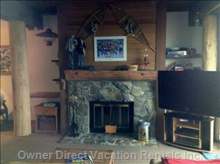Livingroom has Woodburning Fireplace and is Tastefully Decorated