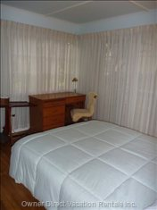 Front Bedroom - Double Bed, Desk.  When Curtains Are Opened, Flooded with Light--looks out onto Deck and Front Garden