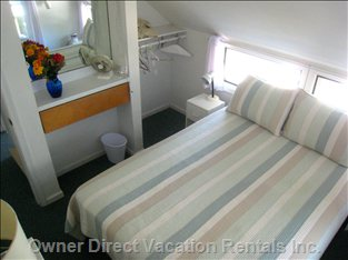 Ponyisland Rental's  Queen Stateroom has TV and DVD